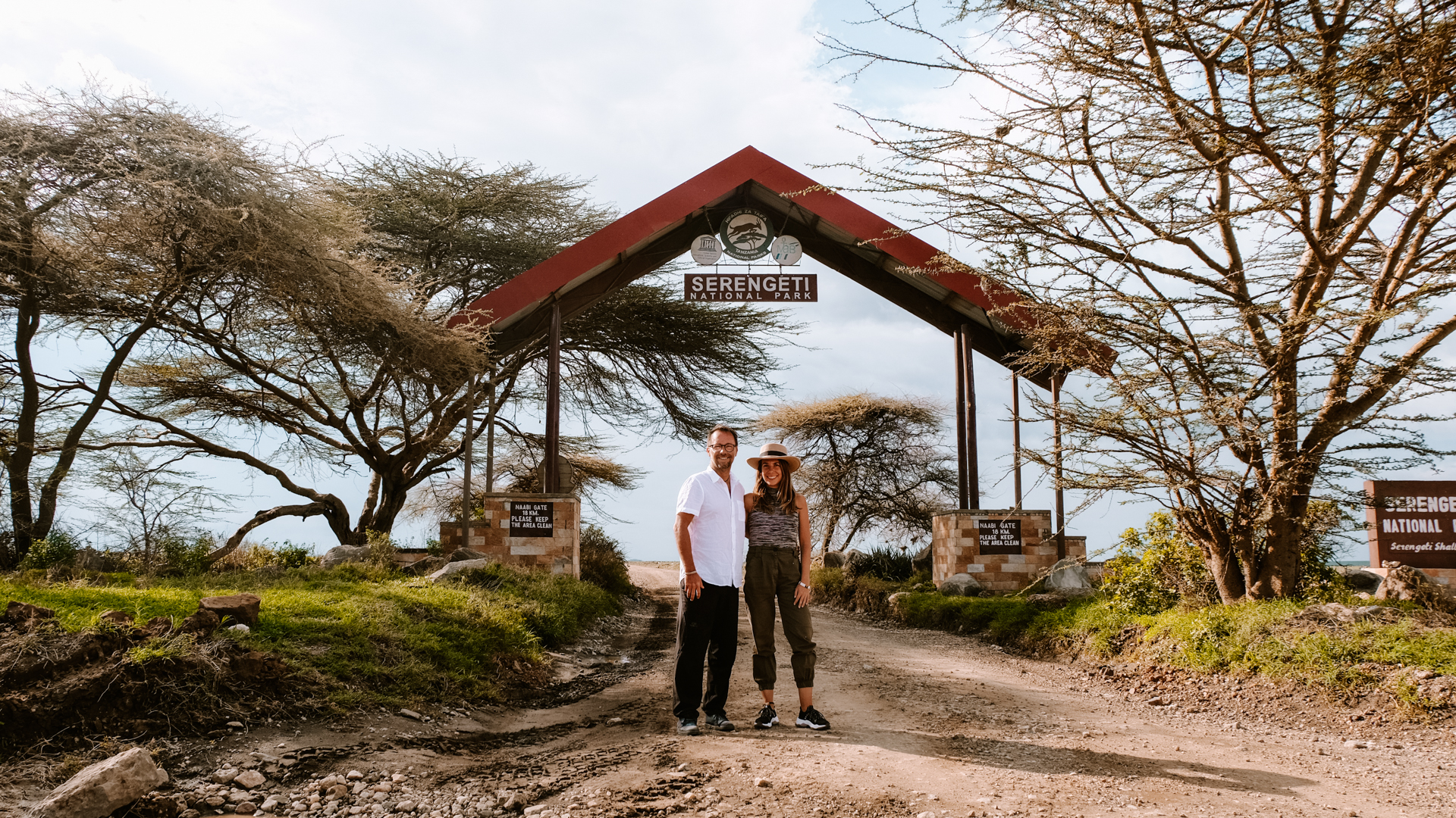 Standing at the gate of the Serengeti National Park in the middle of the savanna