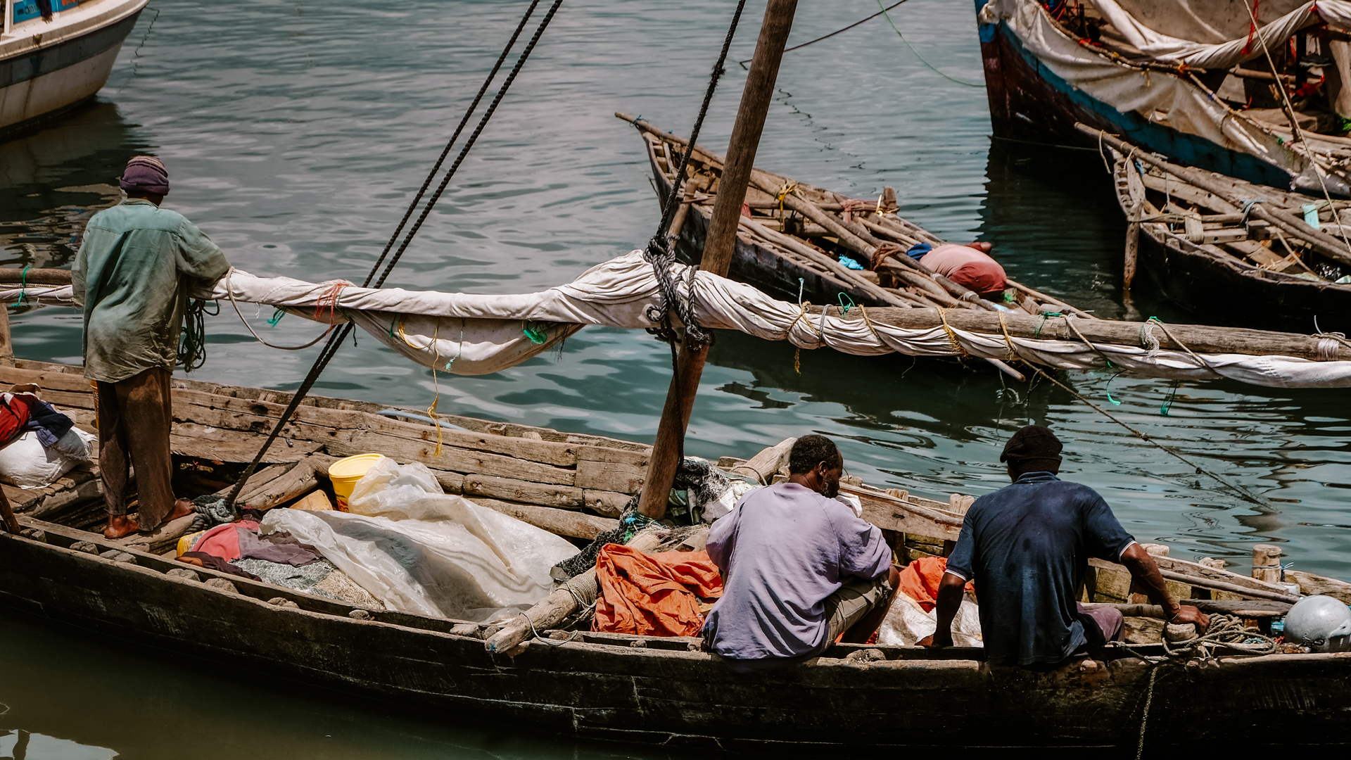 The fishermen getting their boats ready by the waterfront of Stone Town in Zanzibar, Tanzania