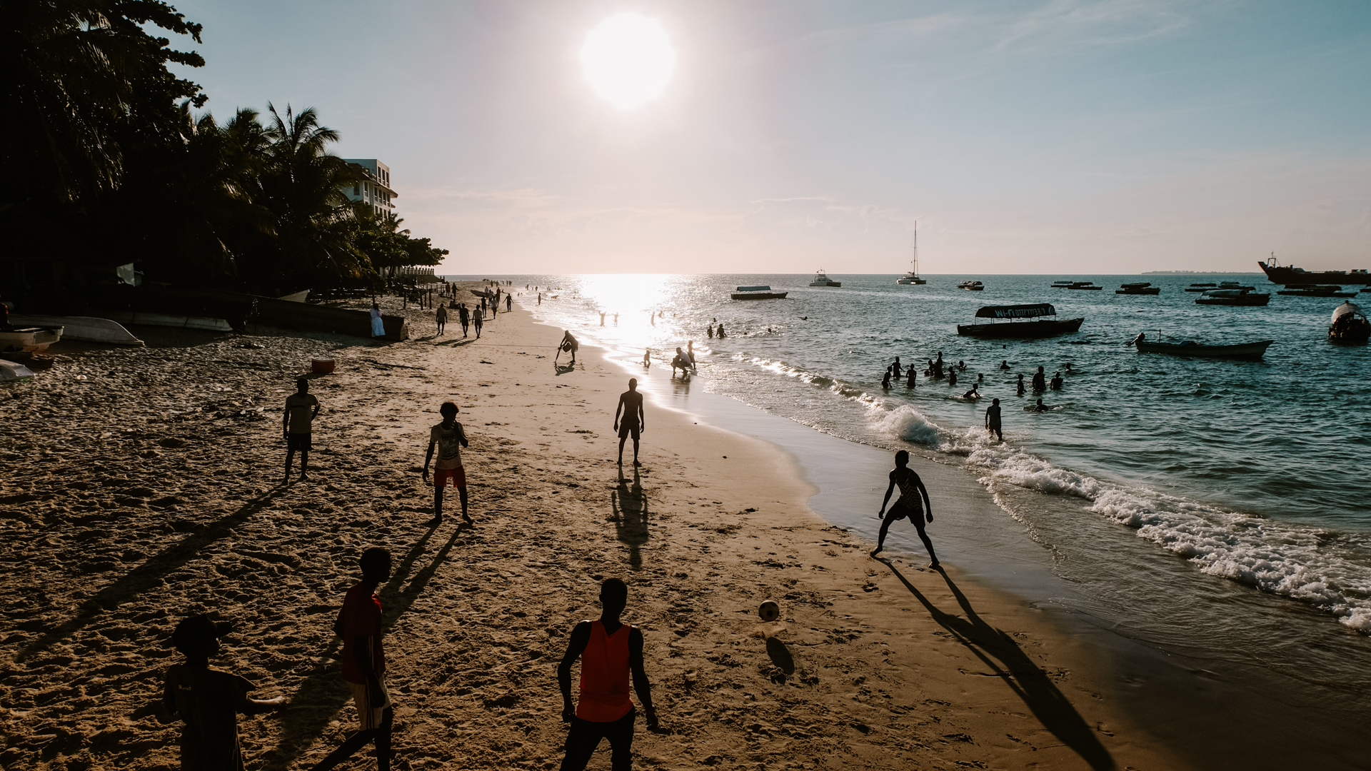 Kids playing football on the beach in our last sunset in Stone Town in Zanzibar, Tanzania